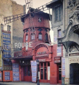 A rare color photograph by Albert Kahn of the original Moulin Rouge in Paris, a year before it...png